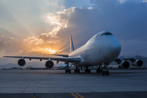 Cargo Airplane On Airport at sunset