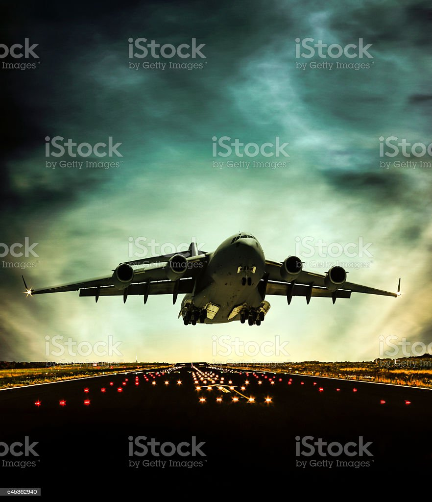 Cargo Airplane taking off at dusk stock photo