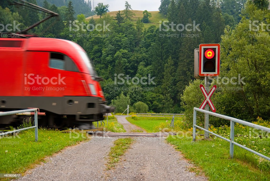 Cargo at a level crossing royalty-free stock photo