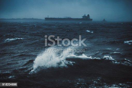 Cargo boat sailing in a rough sea