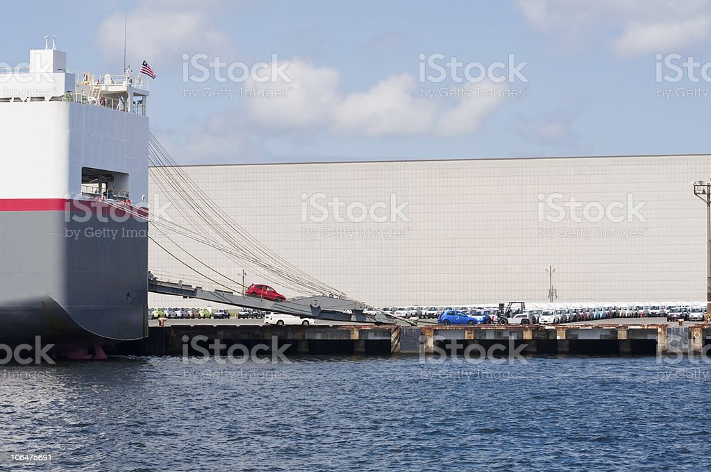 Cargo boat unloading cars at a port in Yokosuka, Japan. Imported cars...