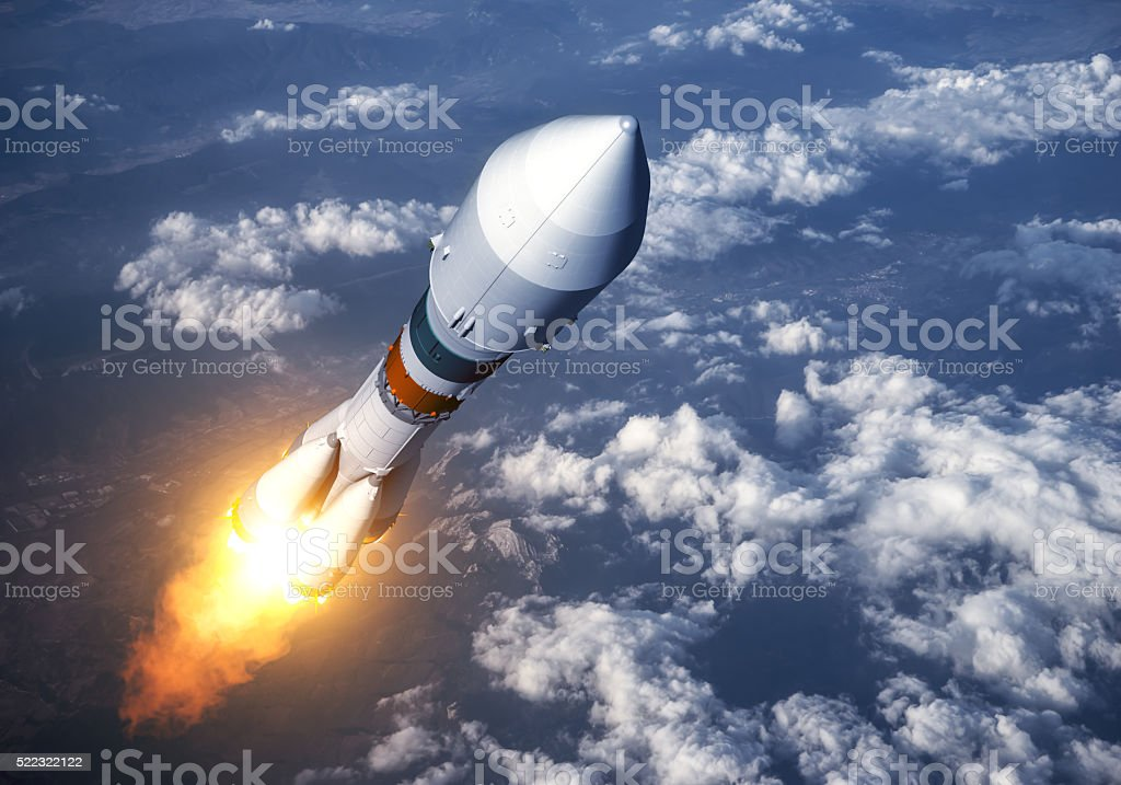 Cargo Carrier Rocket Launch In The Clouds stock photo