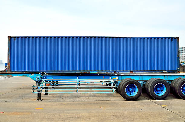 Cargo container and semi trailer chassis stock photo