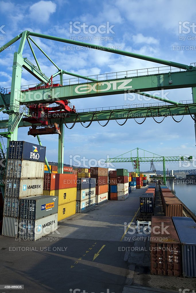 Cargo containers and crane at harbor, Neckar River, Stuttgart, Germany royalty-free stock photo