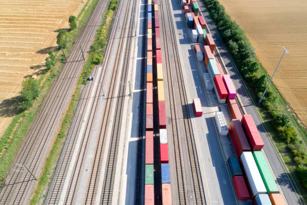 Cargo Containers and Freight Trains, Aerial View stock photo