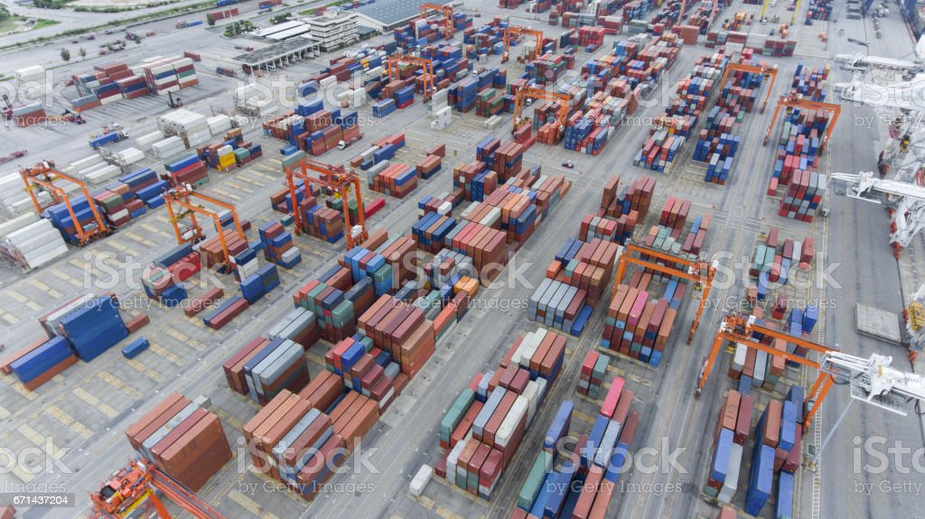 Cargo containers at seaport in aerial view stock photo