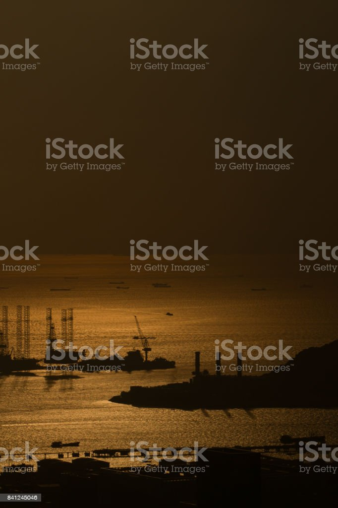 Cargo Containers - container ship deep sea harbor at sunset stock photo