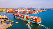 istock Cargo containers ship logistics transportation Container Ship Vessel Cargo Carrier. import export logistic international export and import services export products worldwide 1212979492