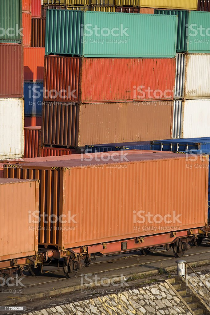 Cargo Containers Stacked at Harbor and Loaded On Train Wagons royalty-free stock photo