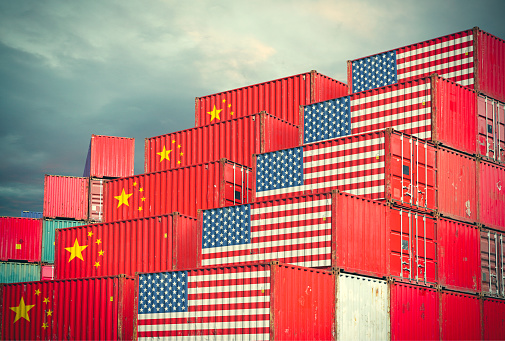 istock Cargo containers with Chinese and United States flag 943639230