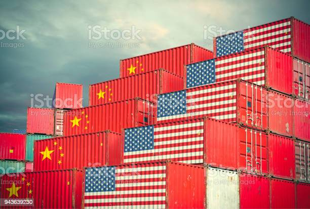 Cargo containers with Chinese and United States flag Chinese and United Stases cargo containers reflecting trade war and restrictions in export and import Asia Stock Photo