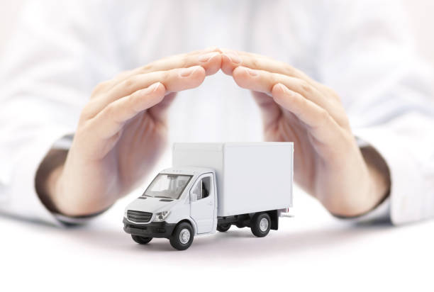 Cargo delivery truck protected by hands stock photo