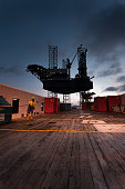A member of ships crew prepares the Main Deck for discharge of container to an oil rig