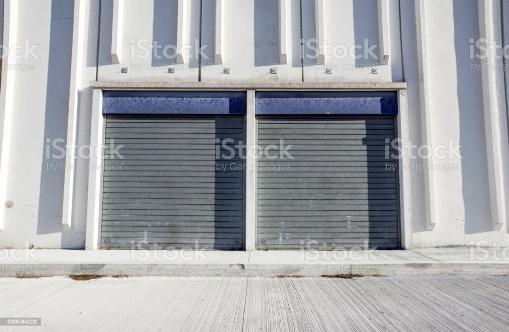 Cargo Gate Of Industrial Warehouse. Industrial Door. View On The One Gates  Of Big