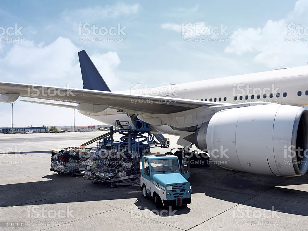 Cargo Plane Being Loaded stock photo