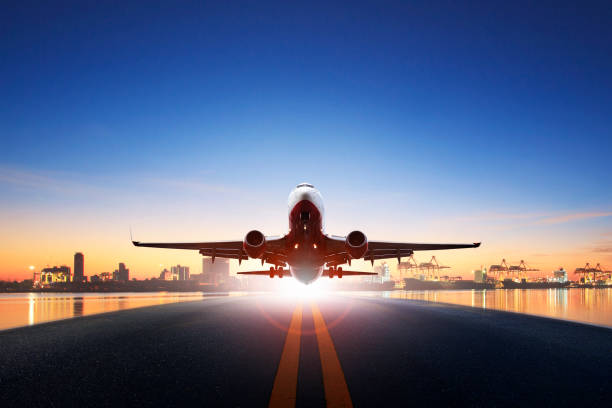 cargo plane take off from airport runways stock photo