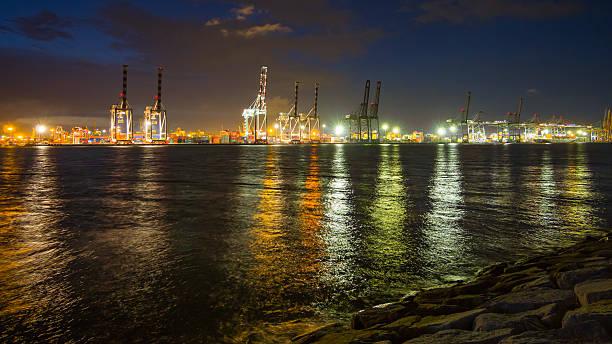 Cargo port at night stock photo