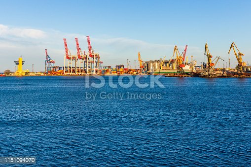 Cargo Port on the Black Sea coast, Odessa, Ukraine. View from afar on yellow loading cranes and containers