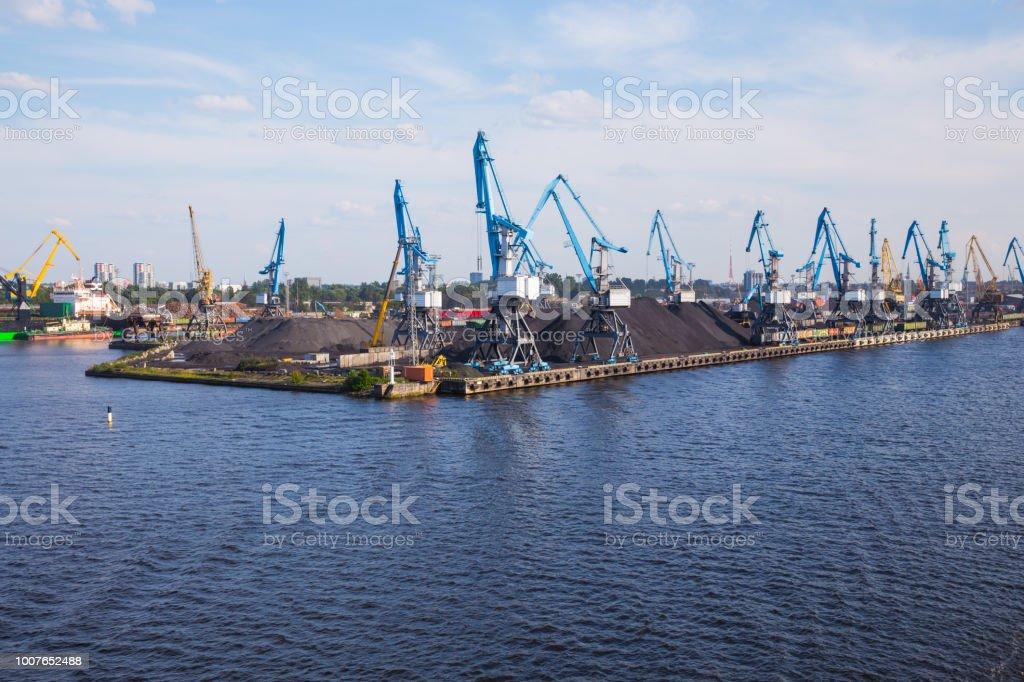 City Riga, Latvia. Cargo port, ships and river Daugava. Big ships,...