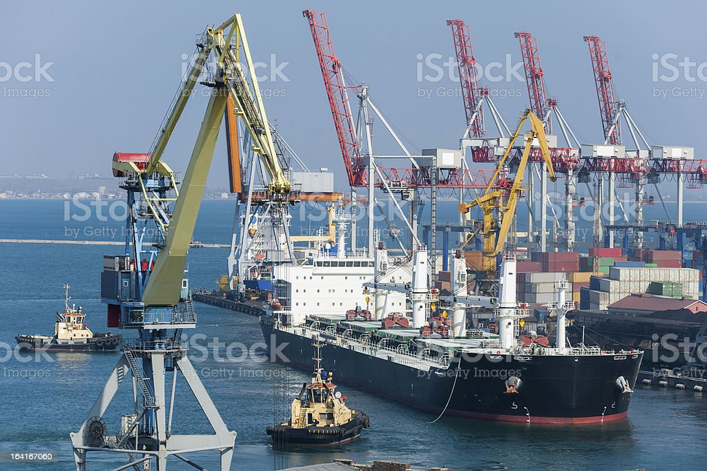 cargo ship and tug boat in port royalty-free stock photo