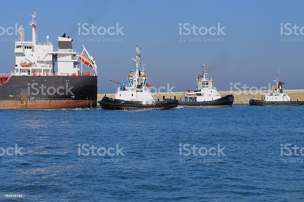 Cargo Ship and Tugboats royalty-free stock photo