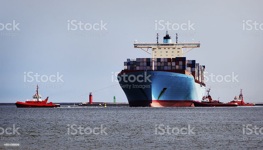 Cargo Ship and Two Lighthouses royalty-free stock photo