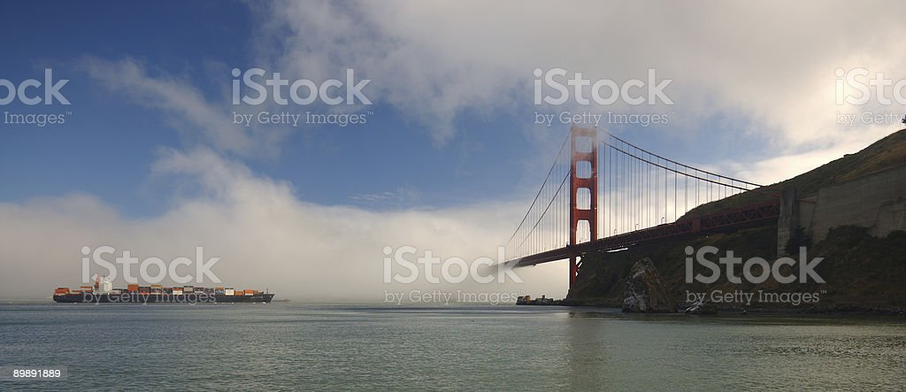 Cargo ship approaching Golden Gate Bridge royalty-free stock photo