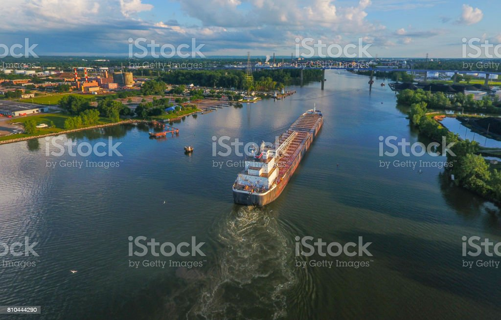 Cargo ship arriving in the port city stock photo