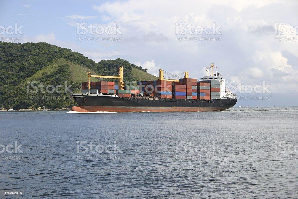 Cargo ship arriving stock photo