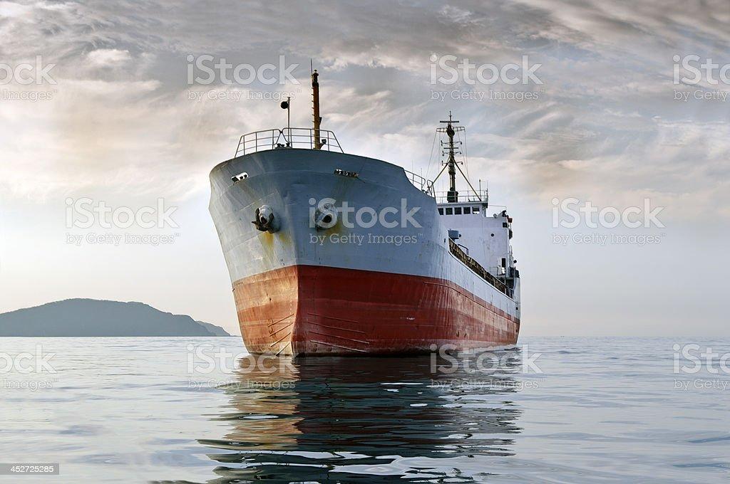 cargo ship at sea stock photo