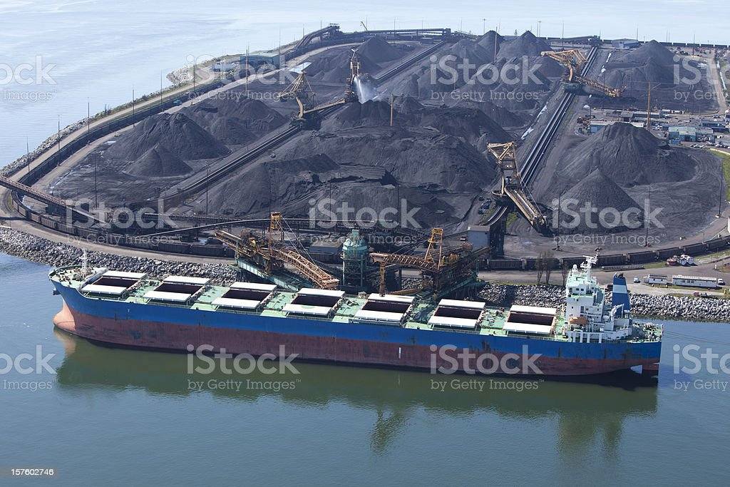 Cargo Ship being loaded with Coal stock photo