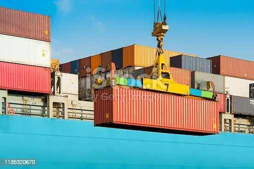 Cargo ship being loaded with containers at port in Chile
