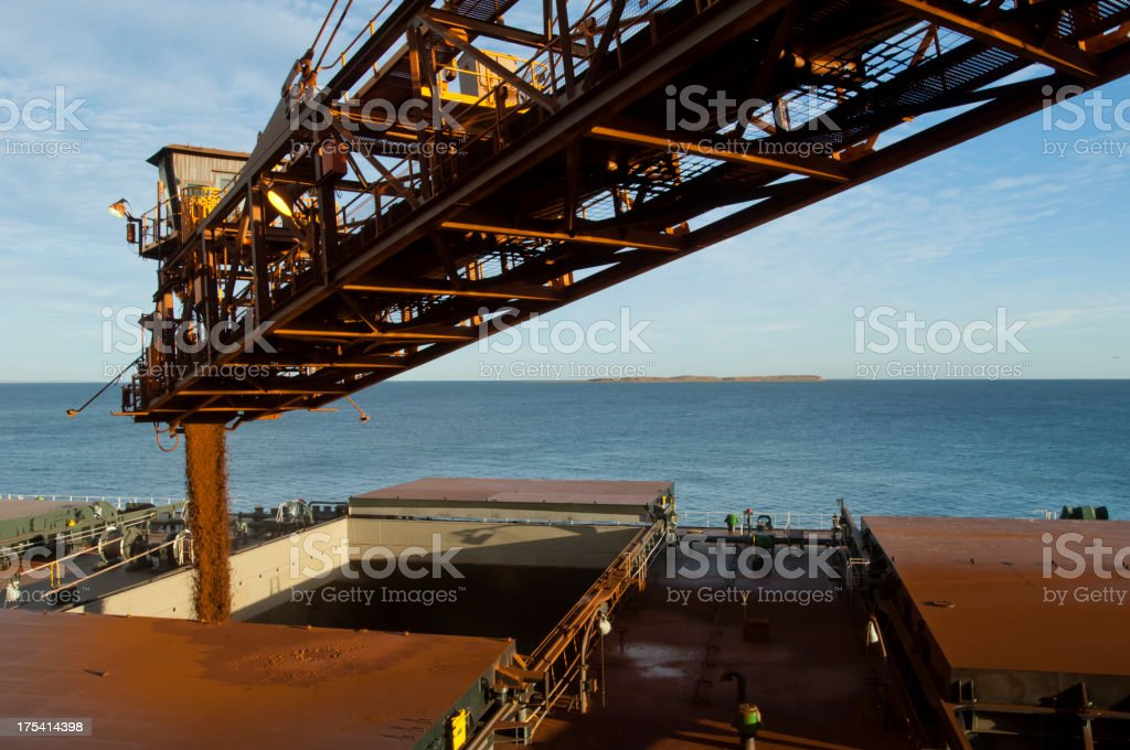 Cargo ship being loaded with crushed ore. royalty-free stock photo