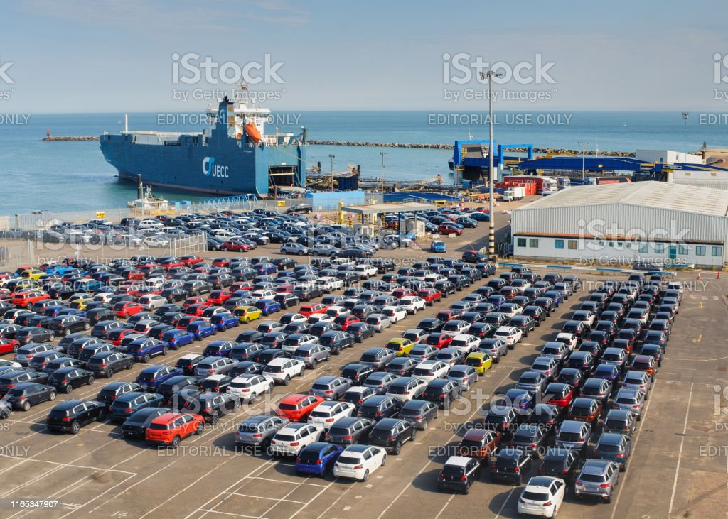 Ramsgate, UK - July 26 2019. A cargo ship bringing new cars into...