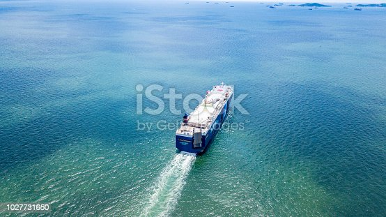483418977istockphoto Cargo ship carries the container heading to the port where is many cranes at the edge. It is the important part of imported and exported economy. 1027731650