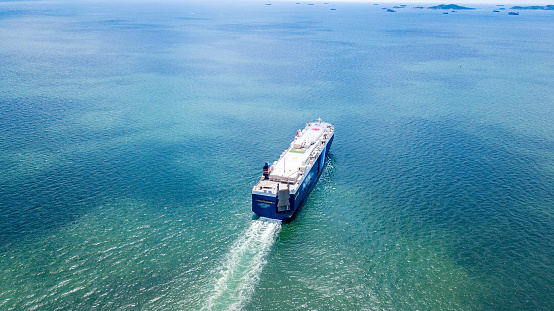 483418977 istock photo Cargo ship carries the container heading to the port where is many cranes at the edge. It is the important part of imported and exported economy. 1027731650