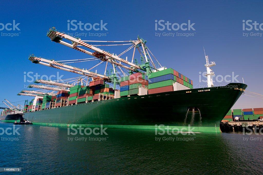 Cargo ship docked at a loading dock stock photo
