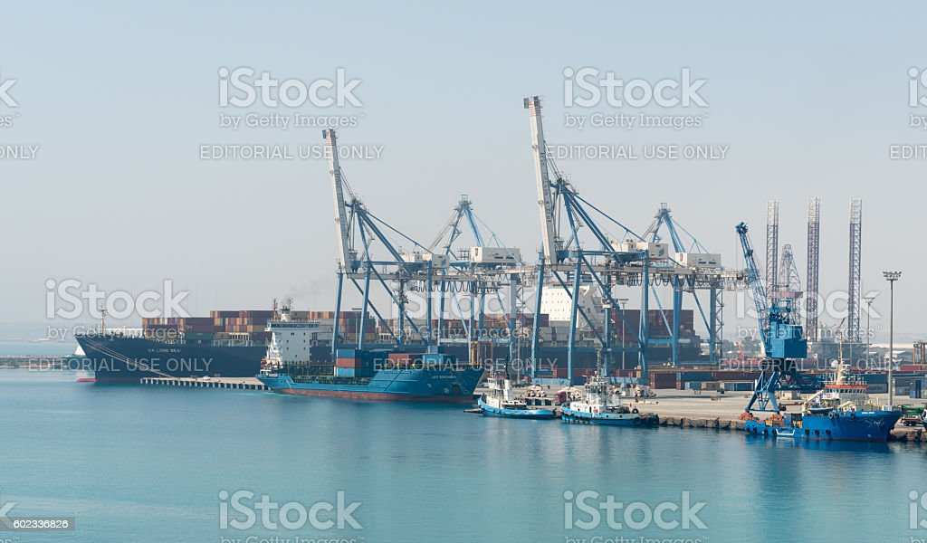 Cargo ship docking stock photo