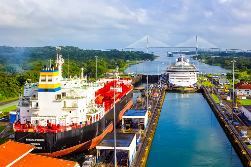 Panama Canal, Panama - December 7, 2019: A cargo ship entering the Miraflores Locks in the Panama Canal, in Panama