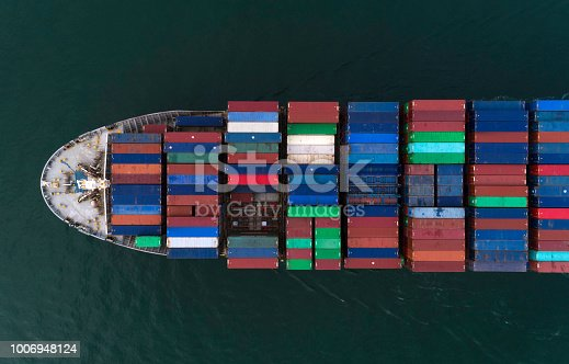 Partial view of a cargo ship loaded with containers seen from above. Aerial view.