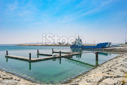 Cargo Ship in a Quiet Harbor