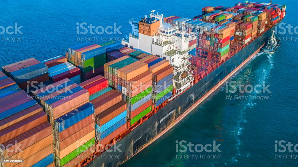 Cargo ship in import export and business logistic, Logistic and transportation of International Container Cargo ship in the open sea. Cargo ship in import export and business logistic, Logistic and transportation of International Container Cargo ship in the open sea. Above Stock Photo