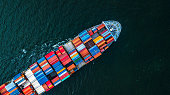 Cargo ship in import export and business logistic, Logistic and transportation of International Container Cargo ship in the open sea, Aerial shot from drone, Thailand.