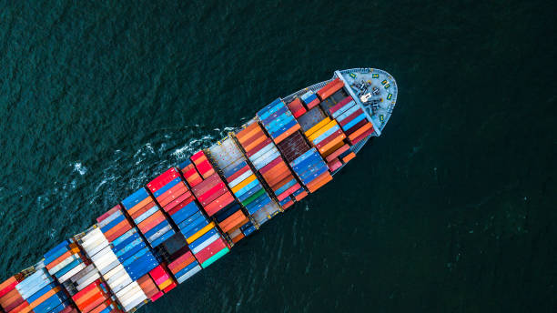 cargo ship in import export and business logistic, logistic and transportation of international container cargo ship in the open sea, aerial shot from drone. - logistica foto e immagini stock