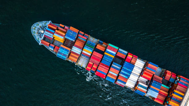 Cargo ship in import export and business logistic, Logistic and transportation of International Container Cargo ship in the open sea, Aerial shot from drone. stock photo
