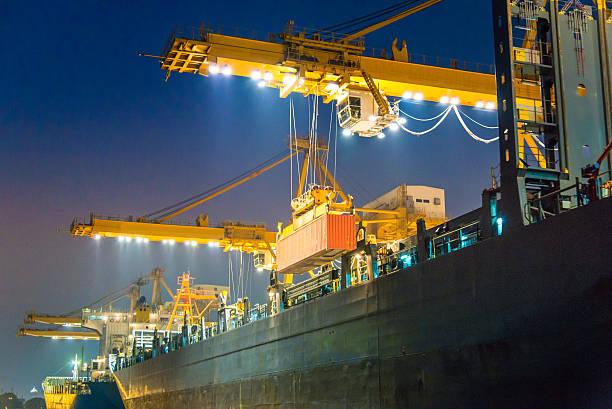 Cargo ship in the harbor at night stock photo