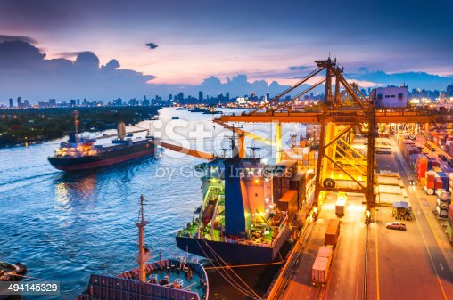 637816284istockphoto Cargo ship in the harbor at sunset . 494145329