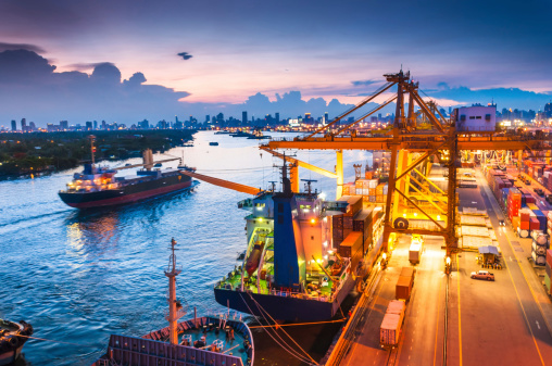 637816284 istock photo Cargo ship in the harbor at sunset . 494145329