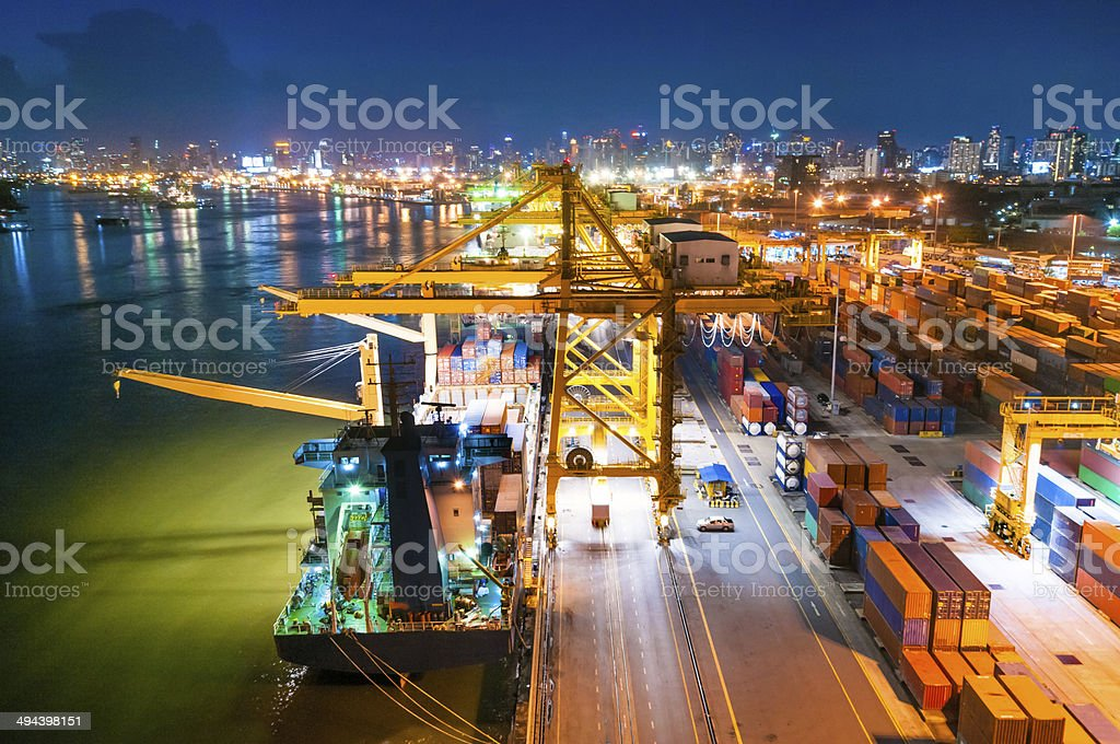 Cargo ship in the harbor at sunset . royalty-free stock photo