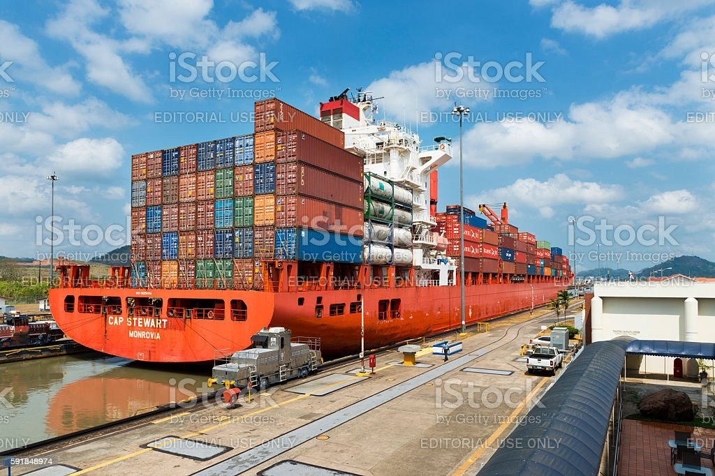 Cargo ship in the Miraflores Locks in the Panama Canal stock photo
